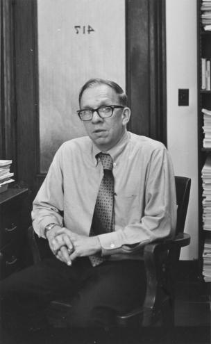 Man with glasses sitting at desk